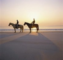 Rancho Carisuva offers sunset horseback riding on the beach.